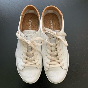 White leather sneakers with tan accents